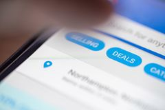 Human finger thumb over Deals button icon on shopping app on smartphone screen closeup.  royalty free stock photos