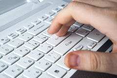 Human fingers on the keyboard Royalty Free Stock Photography