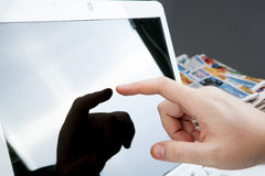 Human fingers on the Tablet PC Royalty Free Stock Image