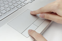 Human fingers on touchpad Royalty Free Stock Photography