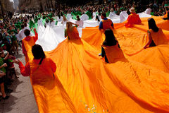 Human Flag Of Ireland Navigates Through Parade Stock Images