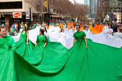 Human Flag Of Ireland Walks Through Parade Stock Image