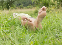 Human foot on the grass Royalty Free Stock Images