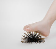 Human foot massage therapy with help of artificial sea urchins model on grey Royalty Free Stock Photos