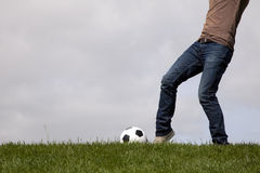 Human foot and a soccer ball Stock Images