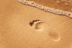 Human footprint on the beach sand. Memories of the sea. Greetings from vacation. Evening on the beach. Human footprint on the beach sand. Memories of the sea Stock Photography