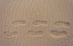 Human footprints. Footprints on the beach looking for the way Royalty Free Stock Images