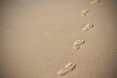 Human footprints on beach sand Stock Images