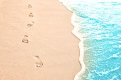 Human footprints on beach sand at resort. In evening royalty free stock photos
