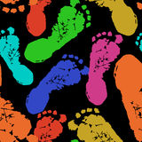 Human footprints on black background vector Stock Images