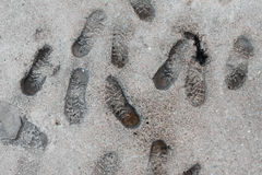Human footprints in the concrete on the waterfront Stock Images