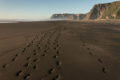 Human footprints on Karekare beach Stock Photos
