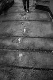 Human Footprints. Outgoing human legs places printed on of concrete Royalty Free Stock Images