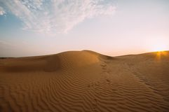 Human footprints in the sand in the desert stock photography