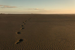 Human footprints in sand on Karekare beach Royalty Free Stock Photos