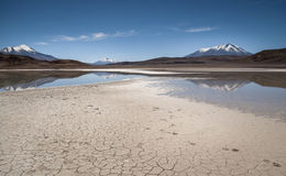 Human footprints in the sand before lake Hedionda, Bolivia Stock Image