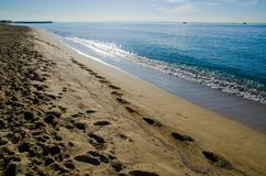 Human footprints on a sandy beach in Palma de Mallorca, Spain. Photographed on a bright sunny day in the summer Royalty Free Stock Photography
