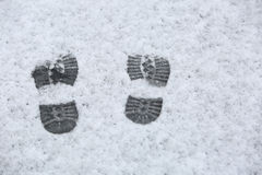 Human footprints in the sleet.  Stock Photo