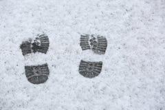 Human footprints in the sleet Stock Photo