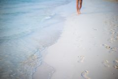 Human footprints on white sand beach Royalty Free Stock Photography