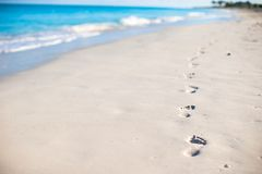 Human footprints on white sand of the Caribbean Royalty Free Stock Photo