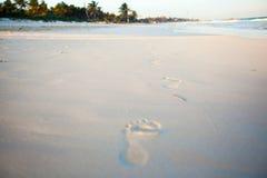 Human footprints on the white sandy beach Royalty Free Stock Photo
