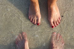 Human foots in sand on the beach. Royalty Free Stock Photo