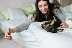 Human friendship with small puppy royalty free stock images