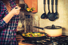 Human frying frozen vegetables. Stir fry. Closeup of human in kitchen cooking stir fry frozen vegetables. Person frying making delicious risotto. Dinner food stock photography