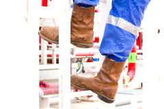 Human going up the stairs on work boots Royalty Free Stock Photos
