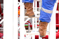 Human going up the stairs on work boots Royalty Free Stock Photo