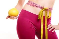 Human with grapefruit measuring waist. Stock Photos