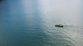 Human in Green Boat Stock Photography
