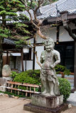 Human guardian. Ancient statue of a guardian human, Kobe, Japan Royalty Free Stock Photo