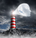 Human Guidance Direction. Business concept with a lighthouse beacon tower shinning a guiding light shaped as a key head on a stormy dark background sky as a stock illustration