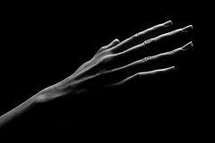 Human hand. Is drawn by light on a black background Royalty Free Stock Photography