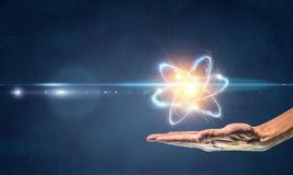 Humankind and science. Human hand and atom molecule as science concept. 3d rendering Royalty Free Stock Photos