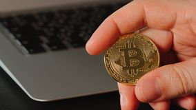 Human hand with the bitcoin on laptop background Royalty Free Stock Photo