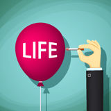 Human hand with a cigarette bursts a balloon with the word life. Stock Photo