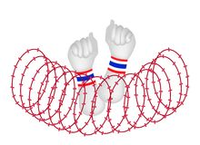 Human Hand Clenched Fist After Wire Barrier. Democraycy Symbol, A Clenched Fist Raised Up in The Air with Thailand Flag Wristband After Barbed Wire Barrier for Royalty Free Stock Image