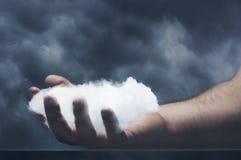 Human hand with cloud Stock Photos