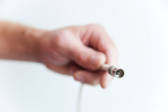 Human hand with coaxial cable Stock Photo