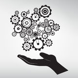 Human Hand with Cogs - Gears Royalty Free Stock Image