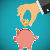 Human hand with coin and piggy bank. Investments and savings. St Royalty Free Stock Photos