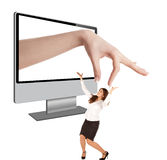 Human hand coming out from computer screen Royalty Free Stock Photography
