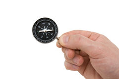 Human hand with compass. Royalty Free Stock Photos