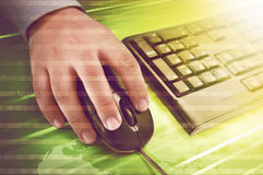 Human hand on computer mouse with keyboard beside him Stock Photos