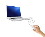 Human hand with computer mouse and laptop Royalty Free Stock Photo