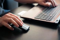 Human hand on computer mouse. Stock Photos