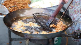 Human hand cooking deep fried ,boiling in oil stock video footage